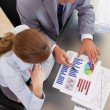 Above view of business working with statistics — Stock Photo