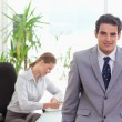 Stock Photo: Tradesmwith colleague behind him