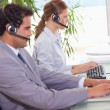 Call center agents working next to each other — Stock Photo