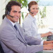 Stock Photo: Side view of call center agents