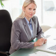 Side view of businesswoman doing her accounting — Stock Photo