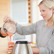 Side view of woman pouring self made smoothie — Stock Photo