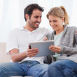 Happy couple using a tablet computer — Stock Photo