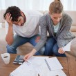 Portrait of depressed couple doing their accounting — Stock Photo #11205823
