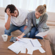 Stock Photo: Depressed couple doing their accounting