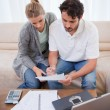 Portrait of a couple doing their accounting with a notebook — Stock Photo