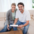 Smiling couple reading a letter — Stock Photo #11205844