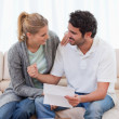 Happy couple reading a letter — Stock Photo #11205851