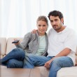 Lovely couple watching TV — Stock Photo