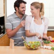 Stock Photo: Young couple slicing vegetables