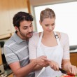 Portrait of a couple cooking — Stock Photo