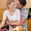 Portrait of a couple eating fruits — Stock Photo