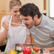 Portrait of a young couple preparing a sauce — Stock Photo #11206094