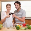 Couple drinking a glass of red wine - Stock Photo