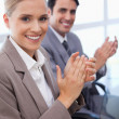 Royalty-Free Stock Photo: Portrait of a smiling business team applauding