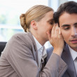 Businesswoman whispering something to her colleague — Stock Photo #11206287