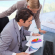 Portrait of a business team looking at a graph — Stock Photo #11206321