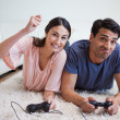 Woman beating her boyfriend while playing video games — Stock Photo