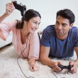Woman beating her fiance while playing video games — Stock Photo #11206567