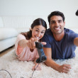 Playful young couple playing video games — Stock Photo