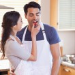 Portrait a woman feeding her husband — Stock Photo
