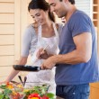 Portrait of a couple cooking with a pan — Stock Photo