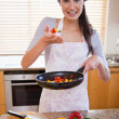 Portrait of a young woman preparing a dish — Stock Photo #11206646