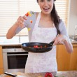 Portrait of a happy woman preparing a dish — Stock Photo #11206647