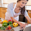 Portrait of a woman looking for a recipe on the internet — Stock Photo #11206649