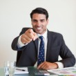 Portrait of a businessman pointing at the viewer — Stock Photo #11206696