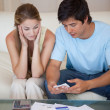 Portrait of couple looking at their bills — Stock Photo #11206936