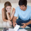 Portrait of a sad couple looking at their bills — Stock Photo