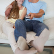 Portrait of a lovely couple watching television — Stock Photo #11206972