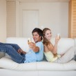 Couple sitting back to back with a glass of sparkling wine — Stock Photo #11206987