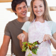 Portrait of a couple making a salad — Stock Photo