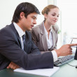 Good looking business working with a computer — Stock Photo