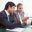 Focused business team working with a computer — Stock Photo