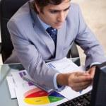 Businessman analyzing statistics — Stock Photo