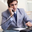Businessman talking on the phone — Stock Photo #11207544