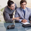 Stockfoto: Businesswoman explaining her colleague what he has to do