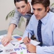 Business team working on statistics together — Stock Photo