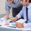 Stock Photo: Business team working on sales statistic
