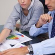 Business team analyzing charts together — Stock Photo