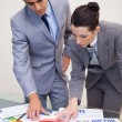Business partners looking at statistics together — Stock Photo
