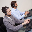 Stock Photo: Side view of call center agents at work