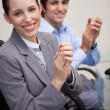 Side view of business team clapping while sitting at desk — Stock Photo #11207806