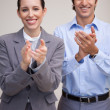 Foto Stock: Standing business team applauding