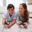 Couple playing video games together - Stok fotoğraf