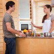 Stock Photo: Couple talking in kitchen
