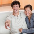 Couple watching television on the couch — Stock Photo